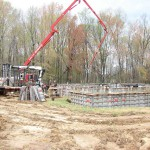 Concrete being poured in to the wall forms